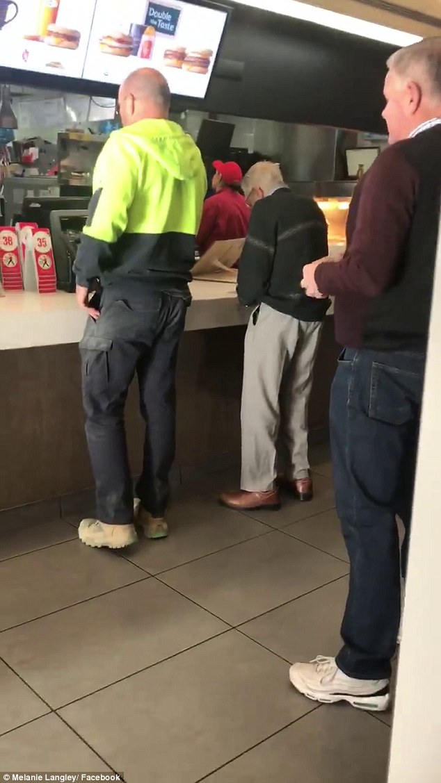 Tradie Dave Love (pictured left) notices the elderly gentleman sifting through heaps of coins and is shown paying for both orders with his card