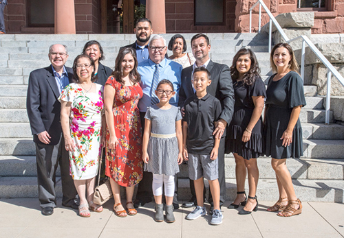 ugh Nguyen, the Orange County Clerk-Recorder, right center, stands with his father, Roy Patterson, of Cookeville, Tennessee, center, along with other members of Nguyens family on the Old Orange County Courthouse in Santa Ana on Friday morning, September 21, 2018.